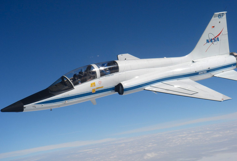 Trainer aircraft on a blue sky